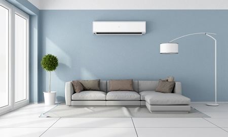 split system air conditioner installed on blue wall.